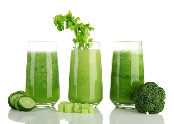 Glasses of green vegetable juice,