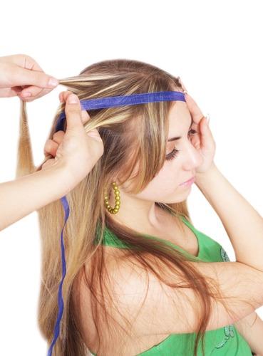 Braiding. Four strand braid with a ribbon