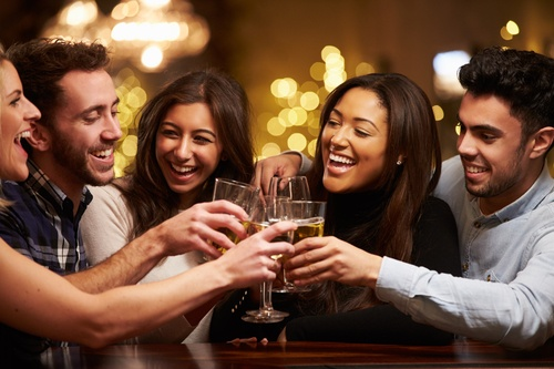 Group Of Friends Enjoying Evening Drinks In Bar