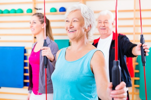 Group at fitness training with gymnastic bar