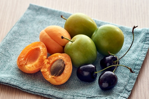 cherries, green plums and apricots