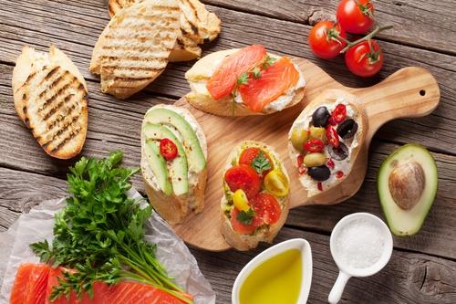 Toast sandwiches with avocado, tomatoes, salmon