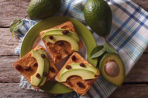 sandwiches with peanut butter and avocado close-up. Horizontal t