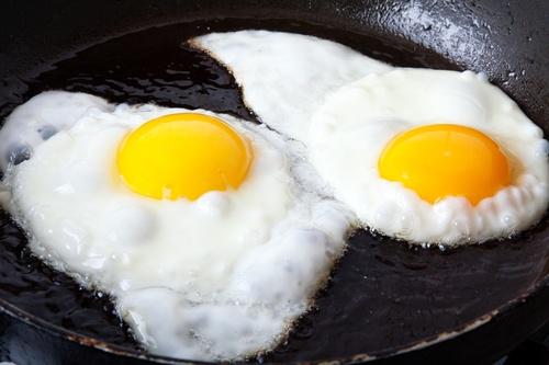 Eggs frying in oil
