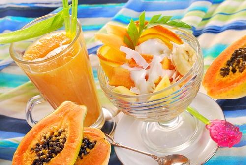 fresh fruits smoothie and salad with papaya,banana,orange,pineap
