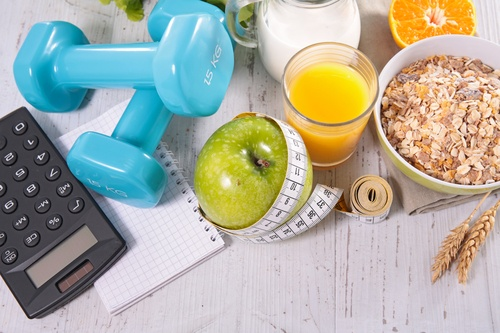 dumbbell and breakfast with measuring tape