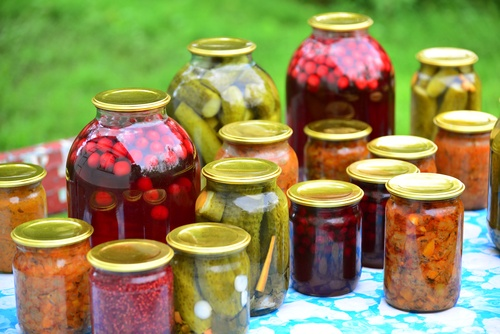Home canned vegetables in the garden in summer