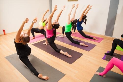 Big group of people in a yoga studio