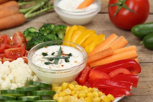 Healthy vegetable food plate with yogurt dip