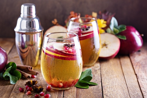 Apple cider cocktail with pomegranate