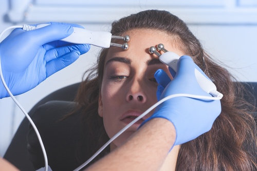 woman cosmetics face treatment