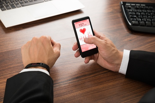 Businessman Checking Heart Rate