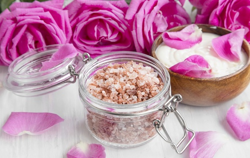 Spa bath salt in a jar with roses and body lotion