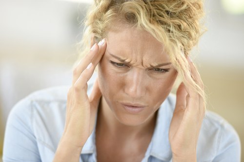 Middle-aged woman suffering headache